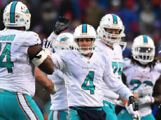 ORCHARD PARK, NY - DECEMBER 24: Matt Darr #4 of the Miami Dolphins celebrates after holding the game tying field goal in overtime against the Buffalo Bills at New Era Stadium on December 24, 2016 in Orchard Park, New York. (Photo by Rich Barnes/Getty Images)