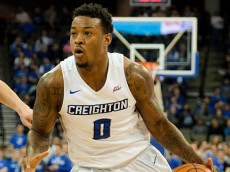OMAHA, NEBRASKA-NOVEMBER 26: Marcus Foster #0 of the Creighton Bluejays drives to the basket past James Fives #25 of the Loyola (Md) Greyhounds during their game at the CenturyLink Center on November 26, 2016 in Omaha, Nebraska. (Photo by Eric Francis/Getty Images)