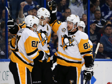 TAMPA, FL - DECEMBER 10: Pittsburgh Penguins center Evgeni Malkin (71) celebrates with Pittsburgh Penguins right wing Phil Kessel (81), Pittsburgh Penguins center Sidney Crosby (87) and Pittsburgh Penguins defenseman Kris Letang (58) after scoring a goal in the second period of the NHL game between the Pittsburgh Penguins and the Tampa Bay Lightning on December 10, 2016, at Amalie Arena in Tampa Florida. (Photo by Mark LoMoglio/Icon Sportswire via Getty Images)