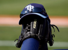 PORT CHARLOTTE, FL - FEBRUARY 27:  A Rays hat and glove sit at the end of the dugout during a Grapefruit League Spring Training Game between the Boston Red Sox and the Tampa Bay Rays at Charlotte Sports Park on February 27, 2009 in Port Charlotte, Florida.  (Photo by J. Meric/Getty Images)
