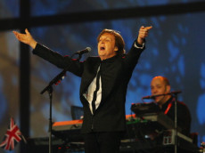 LONDON;UNITED KINGDOM - JULY 27: Sir Paul McCartney performs during the Opening Ceremony of the London 2012 Olympic Games at the Olympic Stadium on July 27, 2012 in London, England. (Photo by Cameron Spencer/Getty Images)