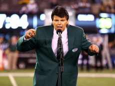 EAST RUTHERFORD, NJ - OCTOBER 08:  Former New York Jets All-Pro defensive lineman Mark Gastineau addresses the crown during a haltime ceremony induction him and former Jets wide receiver Wesley Walker into the Jets' RIng of Honor against the Houston Texans at MetLife Stadium on October 8, 2012 in East Rutherford, New Jersey.  (Photo by Al Bello/Getty Images)