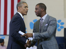 WASHINGTON, DC - JULY 21:  NBA Basketball player Chris Paul (R) Los Angeles Clippers introduces U.S. President Barack Obama at the Walker Jones Education Campus, on July 21, 2014 in Washington, DC. President Obama spoke to area youth about My Brothers Keeper Initiative during a town hall meeting.  (Photo by Mark Wilson/Getty Images)