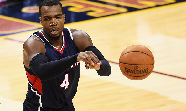 CLEVELAND, OH - MAY 24:  Paul Millsap #4 of the Atlanta Hawks passes against the Cleveland Cavaliers in the third quarter during Game Three of the Eastern Conference Finals of the 2015 NBA Playoffs at Quicken Loans Arena on May 24, 2015 in Cleveland, Ohio. NOTE TO USER: User expressly acknowledges and agrees that, by downloading and or using this Photograph, user is consenting to the terms and conditions of the Getty Images License Agreement.  (Photo by Jason Miller/Getty Images)