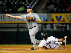 CHICAGO, IL - SEPTEMBER 29: Logan Forsythe #11 of the Tampa Bay Rays throws to first base to complete a double play after forcing out Adam Eaton #1 of the Chicago White Sox during the third inning at U.S. Cellular Field on September 29, 2016 in Chicago, Illinois.  (Photo by Jon Durr/Getty Images)