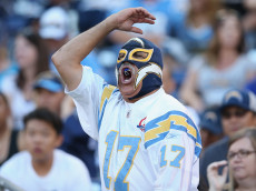 SAN DIEGO, CA - AUGUST 19: A Charger fan in a luche libre mask yells during the game between the Arizona Cardinals and the San Diego Chargers during preseason at Qualcomm Stadium on August 19, 2016 in San Diego, California.  The Chargers won 19-3.  (Photo by Stephen Dunn/Getty Images)