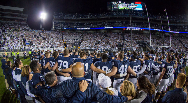 STATE COLLEGE, PA - NOVEMBER 05:  Penn State Nittany Lions players and fans sing to celebrate the team's win over Iowa Hawkeyes on November 5, 2016 at Beaver Stadium in State College, Pennsylvania. Penn State defeats Iowa 41-14.  (Photo by Brett Carlsen/Getty Images)