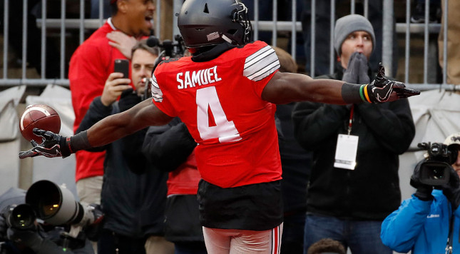 COLUMBUS, OH - NOVEMBER 26:   Curtis Samuel #4 of the Ohio State Buckeyes scores the winning touchdown in double overtime against the Michigan Wolverines at Ohio Stadium on November 26, 2016 in Columbus, Ohio.  (Photo by Gregory Shamus/Getty Images)