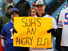 """ORCHARD PARK, NY - DECEMBER 24:  A Buffalo Bills fan hold up a sign reading """"SUH'S AN ANGRY ELF"""" before the game against the Miami Dolphins at New Era Stadium on December 24, 2016 in Orchard Park, New York.  (Photo by Michael Adamucci/Getty Images)"""