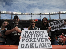 DENVER, CO - JANUARY 1:  Oakland Raiders fans hold signs before the game against the Denver Broncos at Sports Authority Field at Mile High on January 1, 2017 in Denver, Colorado. (Photo by Dustin Bradford/Getty Images)