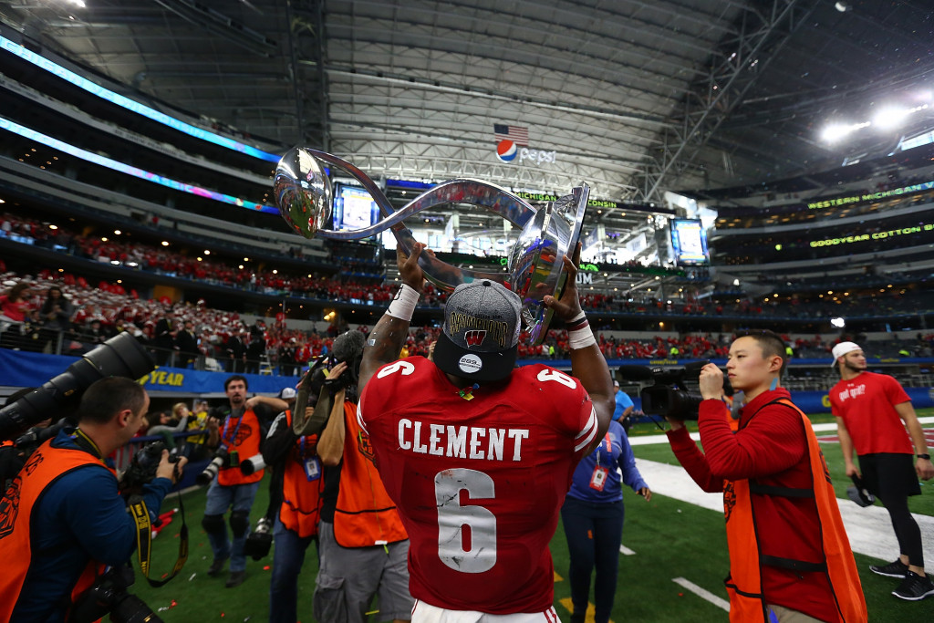 ARLINGTON, TX - JANUARY 02:  Corey Clement #6 of the Wisconsin Badgers holds up the trophy after a 24-16 win against the Western Michigan Broncos during the Goodyear Cotton Bowl Classic at AT&T Stadium on January 2, 2017 in Arlington, Texas.  (Photo by Ronald Martinez/Getty Images)