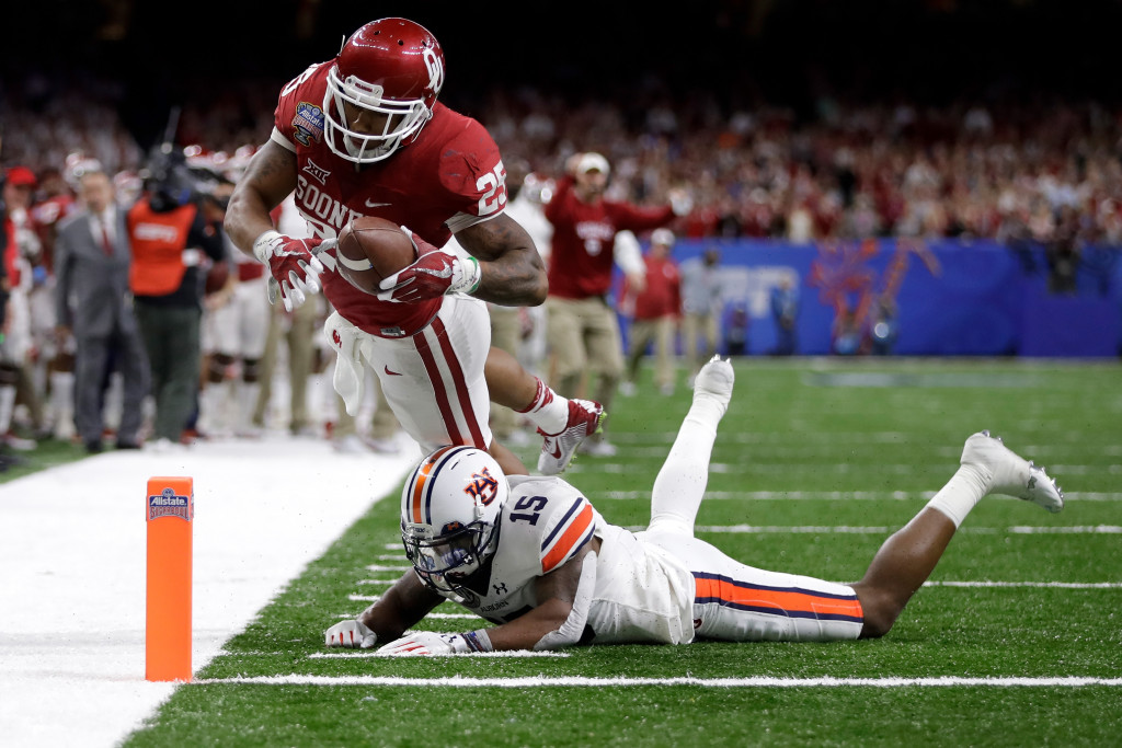 NEW ORLEANS, LA - JANUARY 02:  Joe Mixon #25 of the Oklahoma Sooners scores a touchdown over Joshua Holsey #15 of the Auburn Tigers during the Allstate Sugar Bowl at the Mercedes-Benz Superdome on January 2, 2017 in New Orleans, Louisiana.  (Photo by Sean Gardner/Getty Images)