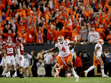TAMPA, FL - JANUARY 09:  Quarterback Deshaun Watson #4 of the Clemson Tigers celebrates after throwing a 2-yard game-winning touchdown pass during the fourth quarter against the Alabama Crimson Tide to win the 2017 College Football Playoff National Championship Game at Raymond James Stadium on January 9, 2017 in Tampa, Florida.  (Photo by Streeter Lecka/Getty Images)