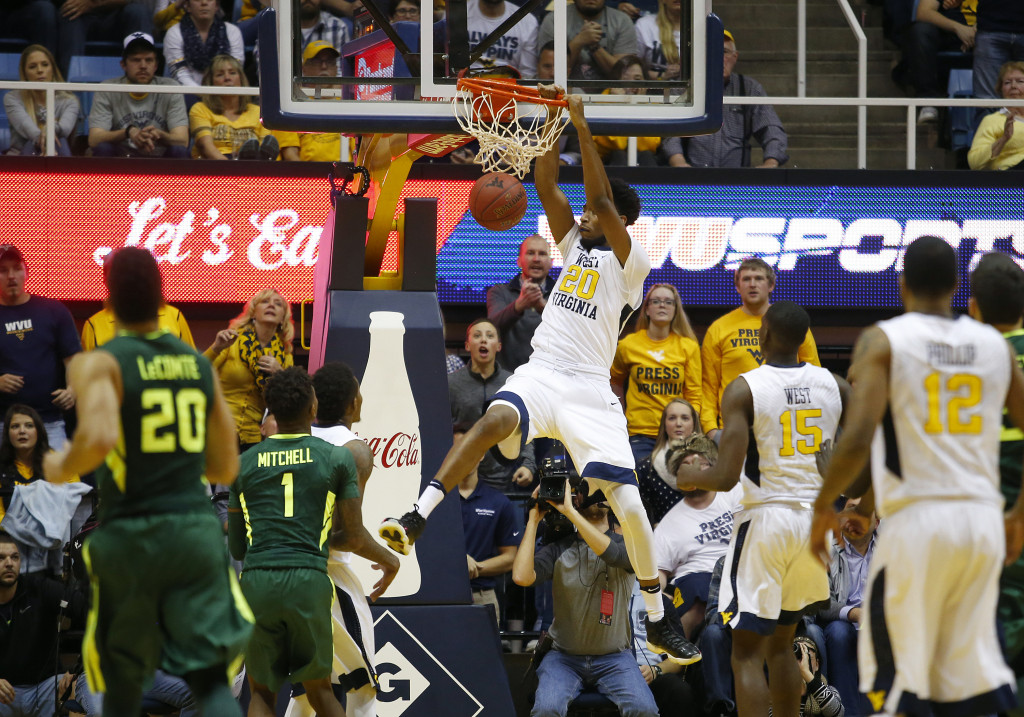 MORGANTOWN, WV - JANUARY 10:  Brandon Watkins #20 of the West Virginia Mountaineers dunks the ball in the second half against the Baylor Bears at the WVU Coliseum on January 10, 2017 in Morgantown, West Virginia.  (Photo by Justin K. Aller/Getty Images)