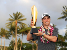 HONOLULU, HI - JANUARY 15:  Justin Thomas of the United States celebrates with the trophy after winning the Sony Open In Hawaii at Waialae Country Club on January 15, 2017 in Honolulu, Hawaii.  (Photo by Sean M. Haffey/Getty Images)