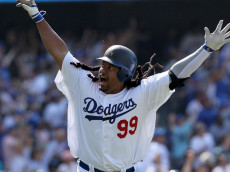 LOS ANGELES, CA - APRIL 18:  Manny Ramirez #99 of the Los Angeles Dodgers celebrates after hitting a two-run homerun in the eighth inning against the San Francisco Giants at Dodger Stadium on April 18, 2010 in Los Angeles, California. The Dodgers defeated the Giants 2-1.  (Photo by Jeff Gross/Getty Images)