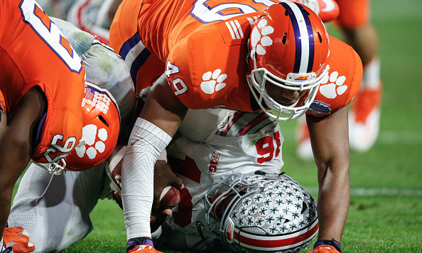 GLENDALE, AZ - DECEMBER 31:  Clemson Tigers defensive end Richard Yeargin (49) sacks Ohio State Buckeyes quarterback J.T. Barrett (16) during the Playstation Fiesta Bowl college football game between the Ohio State Buckeyes and the Clemson Tigers on December 31, 2016 at University of Phoenix Stadium in Glendale, Arizona. (Photo by Kevin Abele/Icon Sportswire via Getty Images)