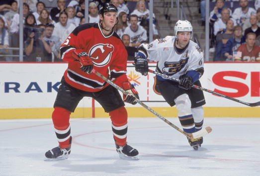 6 Oct 2001:  Colin White #5 of the New Jersey Devils waits for the face off along with Jaromir Jagr #68 of the Washington Capitals during the game at the MCI Center in Washington, D.C. The Capitals defeated the Devils 6-1.Mandatory Credit: Mitchell Layton  /Allsport