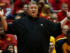 AMES, IA - FEBRUARY 2: Head coach Bob Huggins of the West Virginia Mountaineers coaches from the bench in the first half of play against the Iowa State Cyclones at Hilton Coliseum on February 2, 2016 in Ames, Iowa. (Photo by David Purdy/Getty Images)