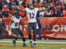Baltimore Ravens Jacoby Jones (12) victorious after scoring touchdown vs Denver Broncos at Sports Authority Field at Mile High. Jones's 70-yard TD catch tied the game in the final minute of regulation. Denver, CO 1/12/2013 CREDIT: John Biever (Photo by John Biever /Sports Illustrated/Getty Images)
