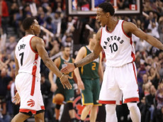TORONTO, ON - JANUARY 05: Kyle Lowry #7 of the Toronto Raptors is congratulated by DeMar DeRozan #10 after scoring a three-pointer against the Utah Jazz during NBA game action at Air Canada Centre on January 5, 2017 in Toronto, Canada. (Photo by Tom Szczerbowski/Getty Images)