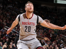HOUSTON, TX - DECEMBER 19:  Donatas Motiejunas #20 of the Houston Rockets boxes out against the Los Angeles Clippers on December 19, 2015 at the Toyota Center in Houston, Texas. (Photo by Bill Baptist/NBAE via Getty Images)