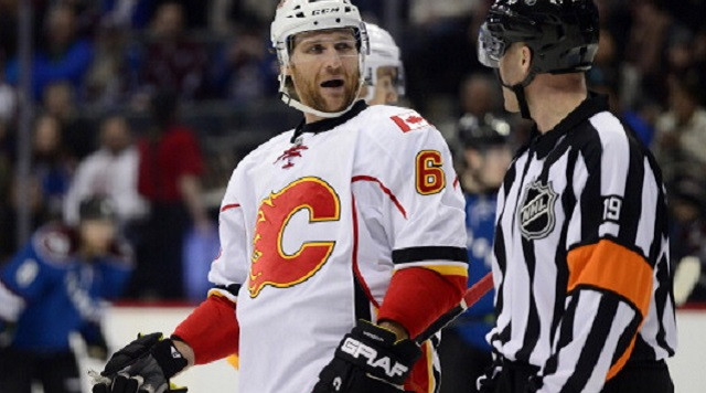 DENVER, CO - JANUARY 06: Dennis Wideman (6) of the Calgary Flames jaws with a referee while playing the Colorado Avalanche during the third period of the Flames' 4-3 win. The Colorado Avalanche hosted the Calgary Flames at the Pepsi Center on January 06, 2014. (Photo by AAron Ontiveroz/The Denver Post via Getty Images)