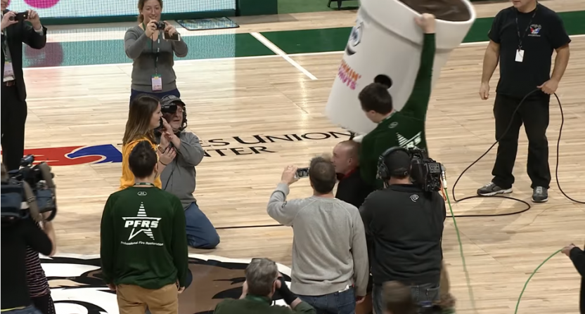 Siena fan's halfcourt shot ends in a surprise proposal