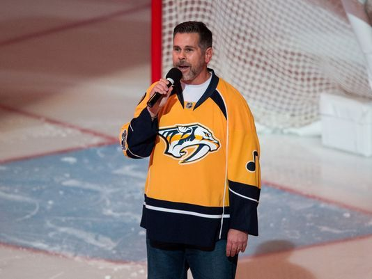 Watch Underwood Sing to Predators Organist's 'The Fighter' Cover