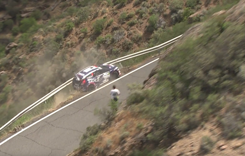 Rally car driver crashes into guardrail buckles it