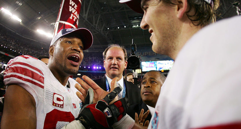 The jersey Michael Strahan (L) wore in the 2008 Super Bowl is now part of a legal battle.