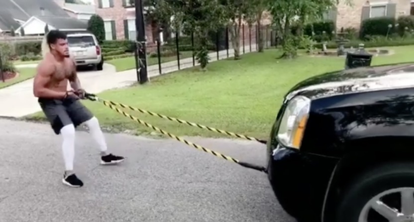 Ex-LSU LB Duke Riley pulls GMC Yukon down street for workout