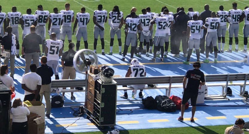 Raiders RB Marshawn Lynch remains seated during national anthem