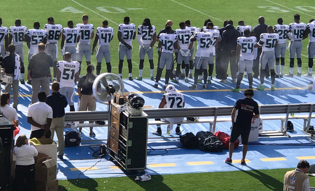 Michael Bennett Sits During National Anthem At Seahawks
