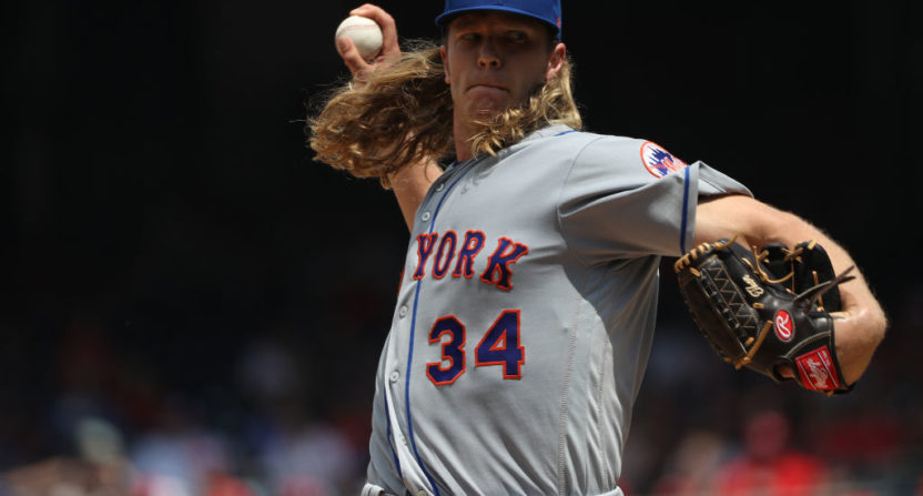 Mets' Noah Syndergaard (lat) throws to hitters Monday