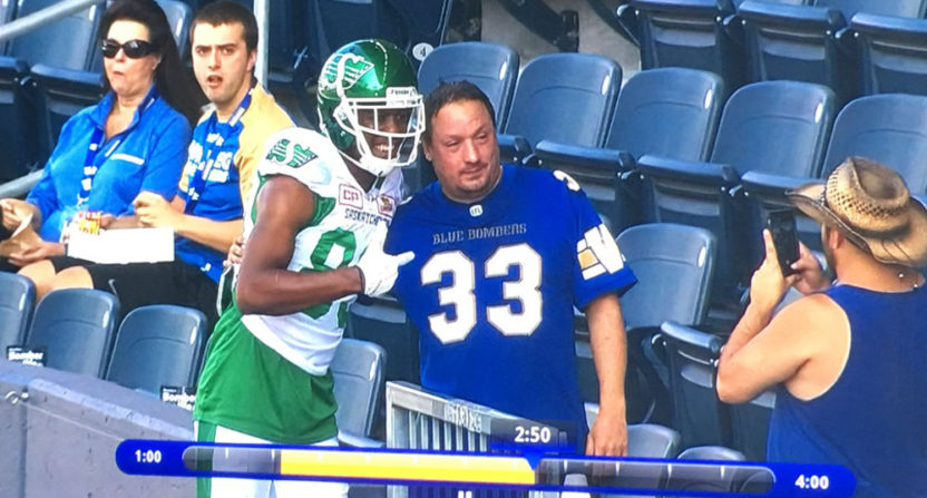 Duron Carter took a photo with an opposing fan Saturday.