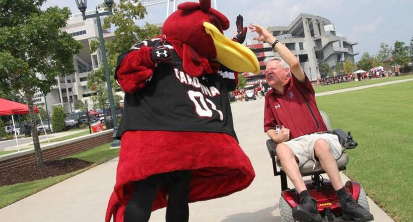 Kirk Hollingsworth with Gamecocks' mascot Cocky.