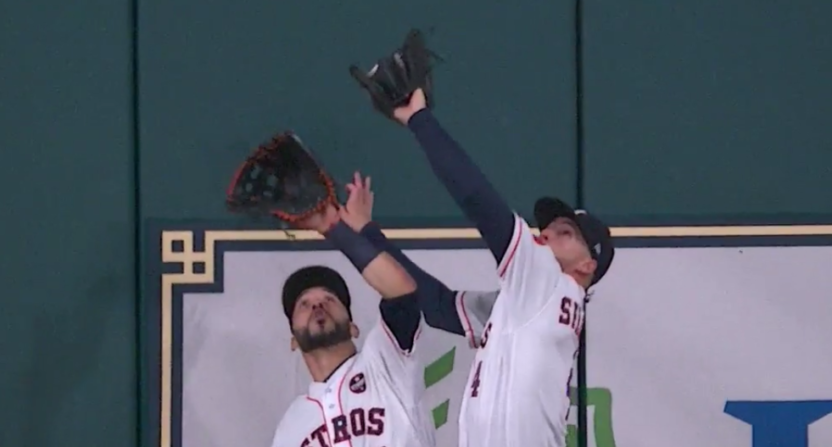 George Springer lept over his teammate for a great catch.