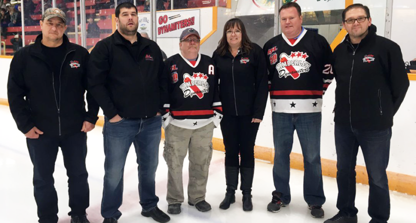 Mike Gould (second from left)'s donation to a junior hockey team is under investigation.