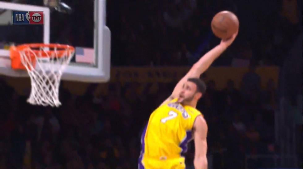 Larry Nance Jr. reaches back for an absurd alley-oop dunk
