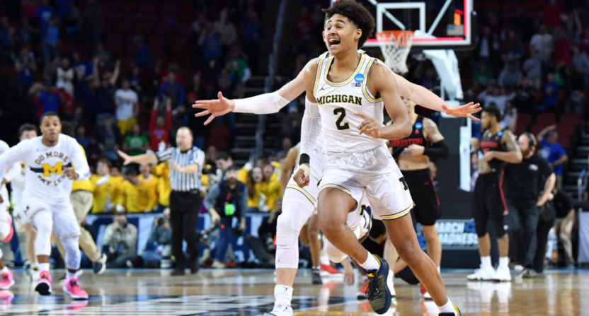 Michigan's Jordan Poole celebrates his game-winning shot.