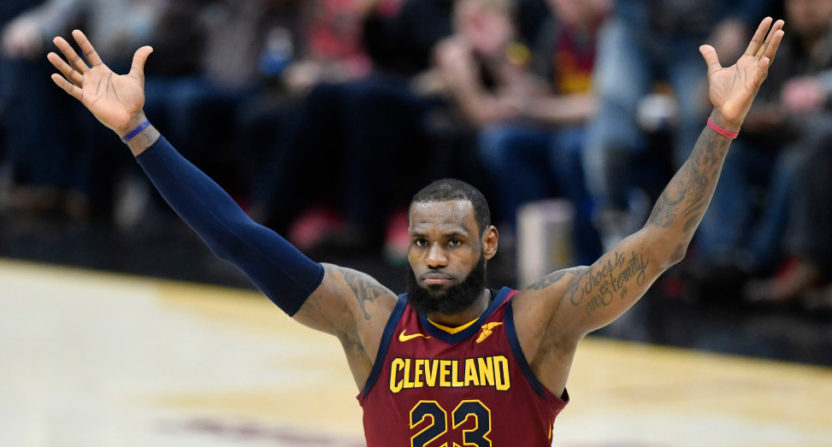 LeBron celebrates the Cavs' improbable comeback after allowing 79 first-half points against the Raptors.