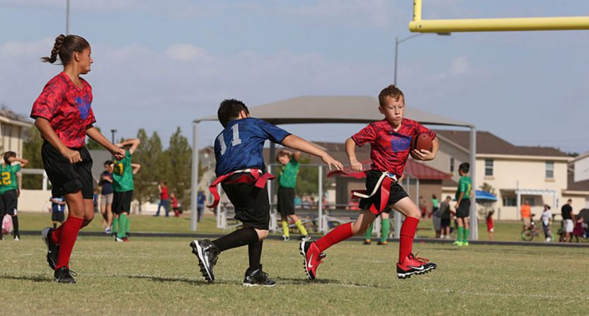 A shot of kids playing flag football.
