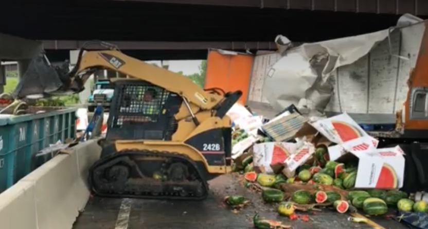 Cleanup after a watermelon truck crashed.