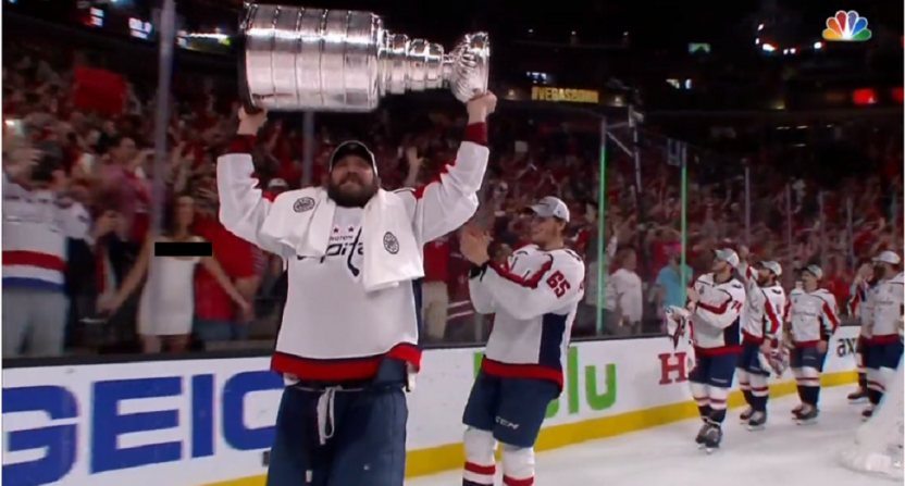 Celebrating Capitals Players Briefly Distracted By Flasher On The Glass