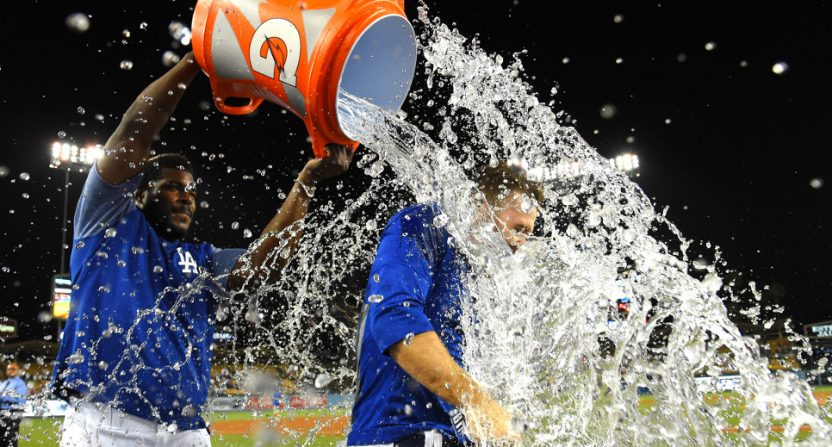 Brian Dozier getting a celebratory shower from Yasiel Puig.