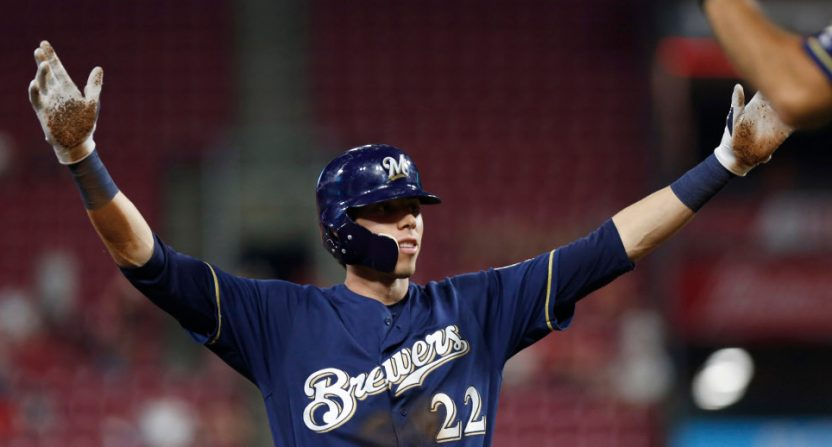 Christian Yelich celebrates his RBI triple that completed his cycle Wednesday.