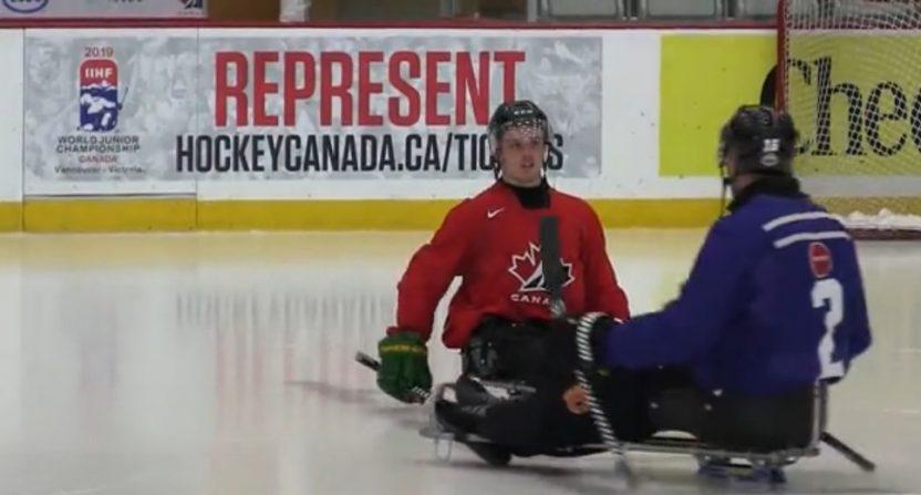 Ryan Straschnitzki playing sledge hockey in August 2018.