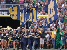 SOUTH BEND, IN - AUGUST 30:  The Notre Dame mascot The Leprechan, leads cheerleaders onto the field before a game between of the Notre Dame Fighting Irish and the Rice Owls at Notre Dame Stadium on August 30, 2014 in South Bend, Indiana. Notre Dame defeated Rice 48-17.  (Photo by Jonathan Daniel/Getty Images)