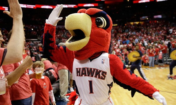 ATLANTA, GA - MAY 01:  Atlanta Hawks mascot Harry the Hawk high fives the fans in Game 6 of the Eastern Conference Quarterfinals against the Indiana Pacers during the 2014 NBA Playoffs at Philips Arena on May 1, 2014 in Atlanta, Georgia.  NOTE TO USER:  User expressly acknowledges and agrees that, by downloading and/or using this photograph, User is consenting to the terms and conditions of the Getty Images License Agreement.  (Photo by Mike Zarrilli/Getty Images)